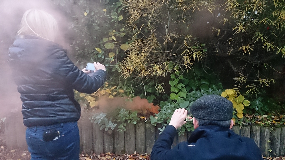 Matt and Caroline capturing the smoke in the trees