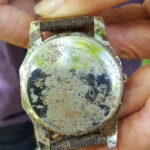 back of the metal watch with rust