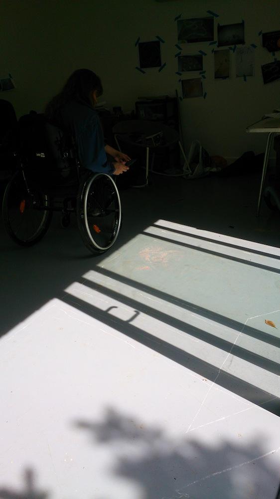 Juliet drawing lines on the studio floor