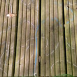 blue and white lines drawn around shadows on the decking