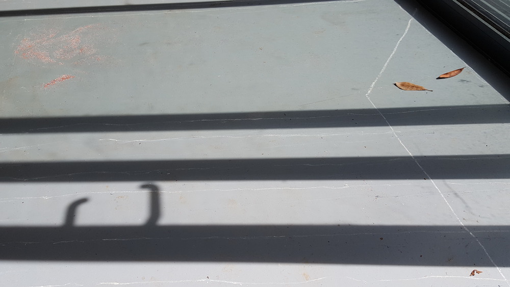 shadows and white lines drawn on the studio floor