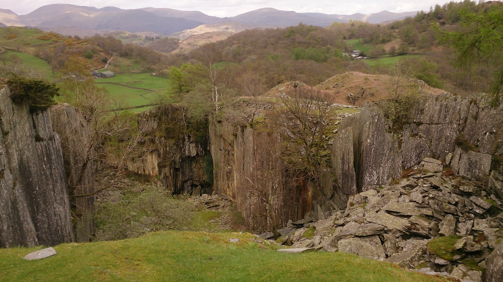 looking over Tilberthwaite Quarry to the mountains and valleys beyond