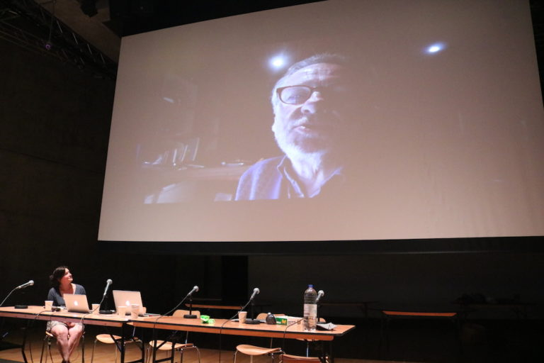 frank's face projected on a large screen
