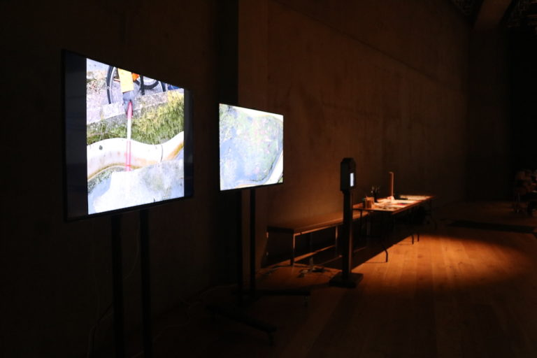 two monitors and the display of artworks and the promises machine